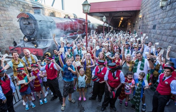 Cheers from guests filled the air at Hogsmeade Station today as Universal Orlando Resort celebrated its one millionth rider on the Hogwarts Express ? the iconic train that transported Harry Potter and his friends between Hogsmeade Station and King?s Cross Station in J.K. Rowling?s beloved series. To celebrate this magical milestone, nearly two hundred guests were given complimentary Butterbeer ice-cream. In early July, guests began boarding the Hogwarts Express to travel between The Wizarding World of Harry Potter ? Hogsmeade in Universal?s Islands of Adventure and The Wizarding World of Harry Potter ? Diagon Alley in Universal Studios Florida. The incredible journey, which requires a park-to-park ticket, combines powerful storytelling, live special effects, lifelike animation and state-of-the-art technology to take riders on the journey of a lifetime. © 2014 Universal Orlando Resort. All rights reserved. HARRY POTTER, characters, names and related indicia are trademarks of and © Warner Bros. Entertainment Inc. Harry Potter Publishing Rights © JKR.  (s14)